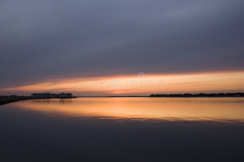 Golden sunset over water royalty free stock photography