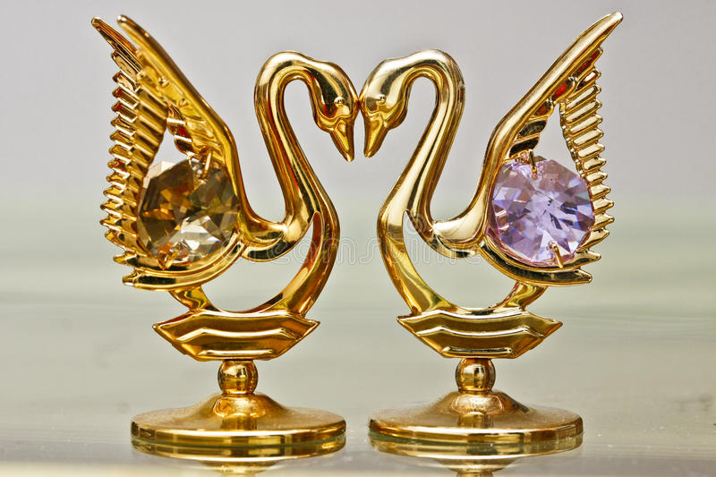 Golden Swans Jewelry with Crystals royalty free stock image