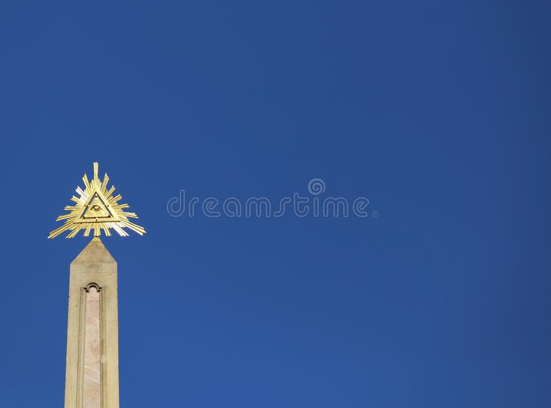 Golden symbol called eye of providence on blue sky. Golden symbol called eye of providence royalty free stock images