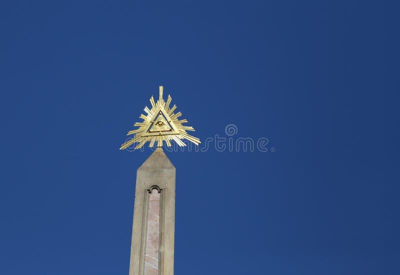 Golden symbol called eye of providence.  stock photos