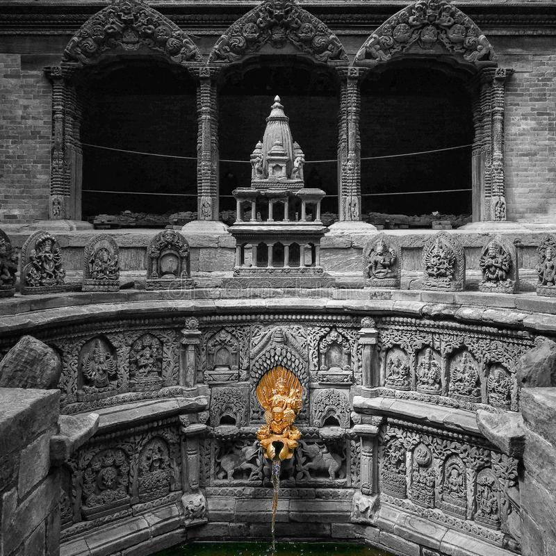 Golden tap at Patan Durbar Square. Miniature model of Krishna Temple located at Sundari Chowk of Patan Durbar Square in Nepal royalty free stock photography