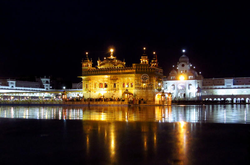 Golden Temple Amritsar, India at night. People in a line to a holy book Harmandir Sahib - Golden Temple, in Amritsar, India. The holy place of worship of the royalty free stock image