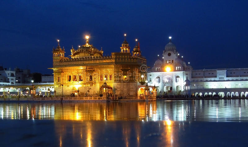 Golden Temple Amritsar, India at night. People in a line to a holy book Harmandir Sahib - Golden Temple, in Amritsar, India. The holy place of worship of the royalty free stock photography