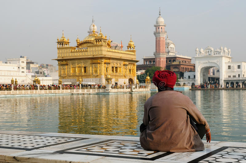 Golden temple at Amritsar, India. INDIA, AMRITSAR - 30 NOVEMBER 2009: The believer of the Sikhism is contemplating on the area of the Golden Temple royalty free stock photography