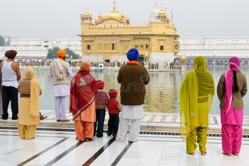 Golden temple at Amritsar, India. INDIA, AMRITSAR - NOVEMBER 29: Pilgrims praying at the Golden temple (Sri Harimandir Sahib), Amritsar in November 29, 2009 royalty free stock photography