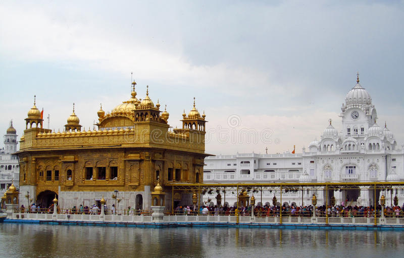 Golden Temple Amritsar, India. People in a line to a holy book Harmandir Sahib - Golden Temple, in Amritsar, India. The holy place of worship of the Sikhs royalty free stock photo
