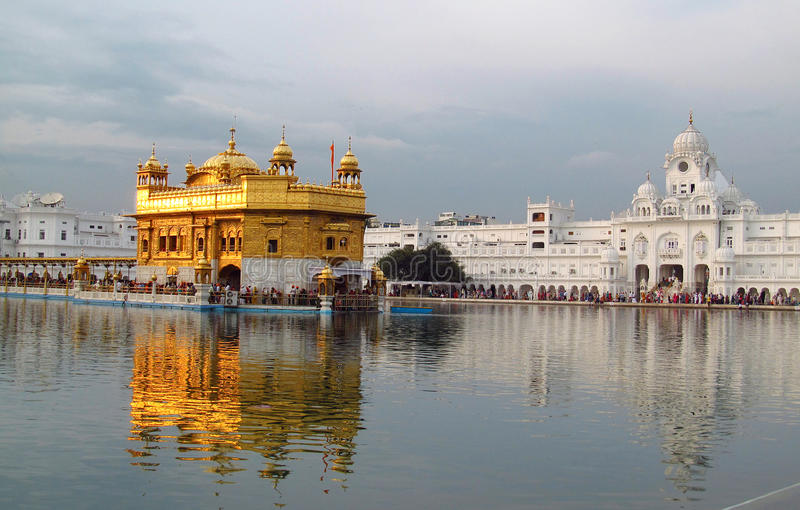 Golden Temple Amritsar, India. People in a line to a holy book Harmandir Sahib - Golden Temple, in Amritsar, India. The holy place of worship of the Sikhs stock images