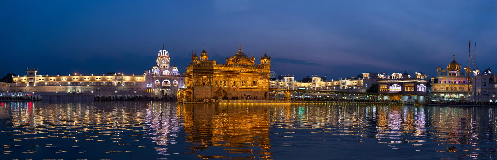 The Golden Temple at Amritsar, Punjab, India, the most sacred icon and worship place of Sikh religion. Illuminated in the night, r. Eflected on lake royalty free stock photo
