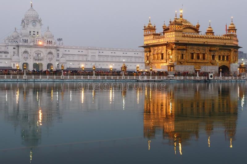 Golden Temple. INDIA, AMRITSAR - NOVEMBER 30: Pilgrims praying at the Golden temple (Sri Harimandir Sahib), Amritsar in November 30, 2010 stock image