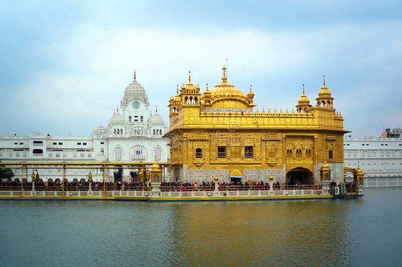 Golden Temple and lake in Amritsar, Punjab, India. Golden Temple. Holiest shrine of the Sikh religion. Ornate gold covered building in the middle of an royalty free stock photo