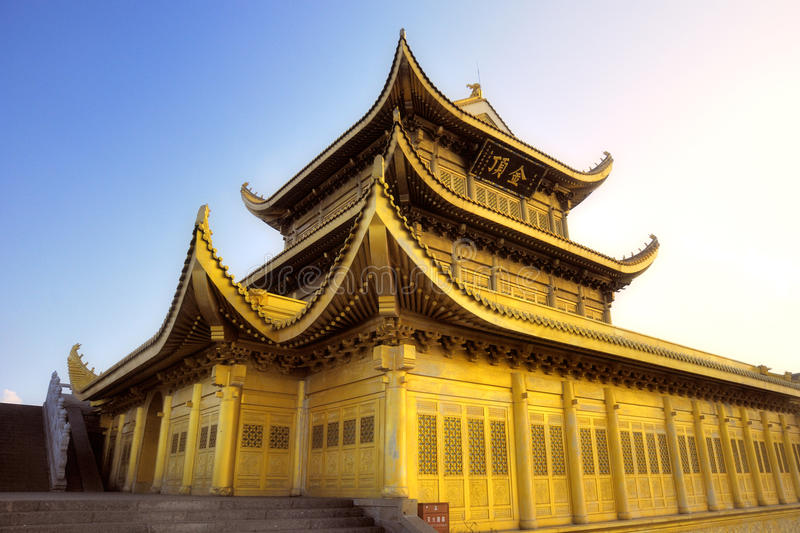 Golden temple at the top of mountain Emei stock image
