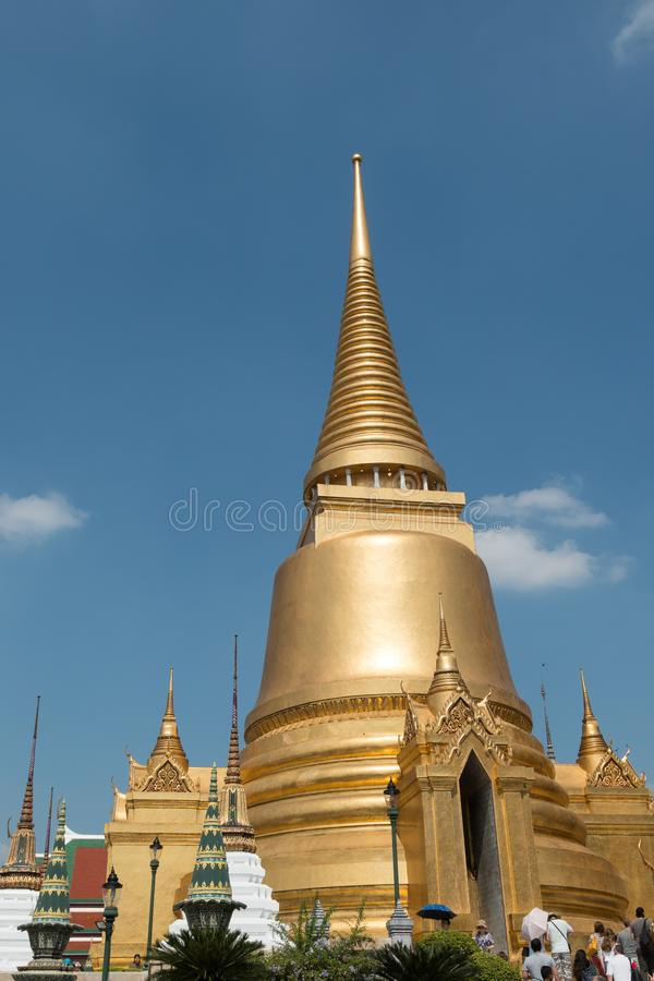 Golden temples and stupa inside the Grand Palace in Bangkok, Thailand, home of the Thai Royal Family. Golden stupa inside the Grand Palace in Bangkok, Thailand stock photo