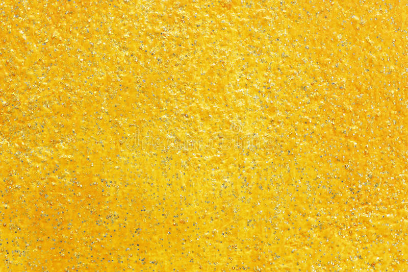 Golden texture with glittering for pattern and background. It is golden texture with glittering for pattern and background stock images