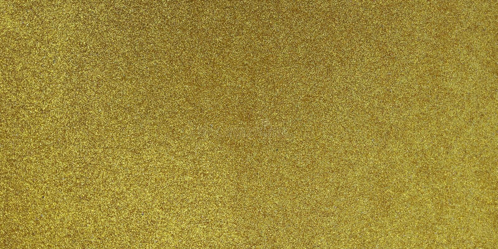 Golden textured background with glitter effect background stock images