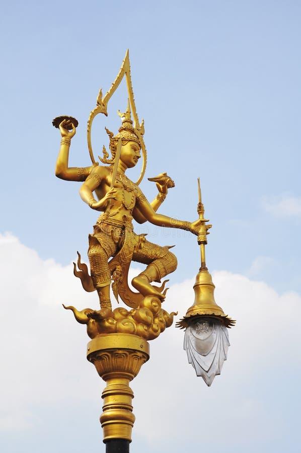 A golden thai angel lighting pole royalty free stock image