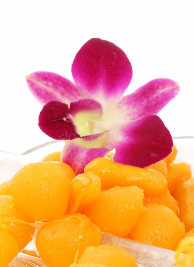 Golden Thai dessert on dish stock image