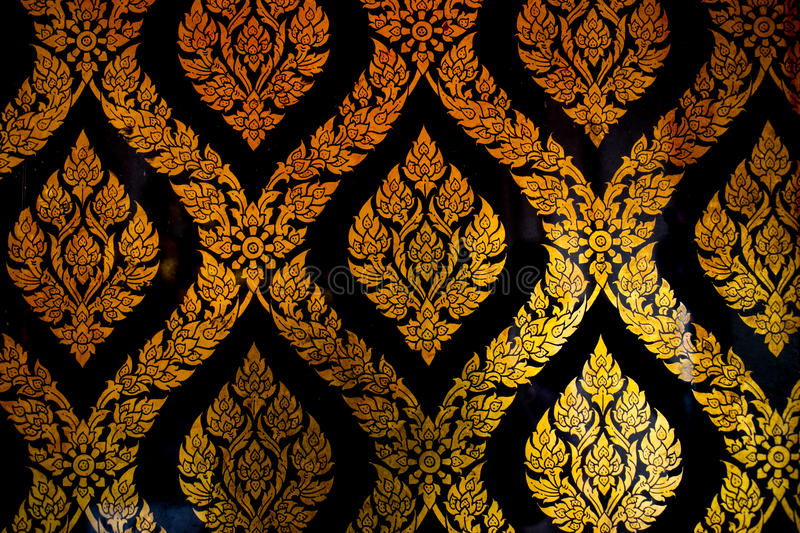 Golden Thai style line art at Wat Pho Temple. Bangkok, Thailand royalty free stock photo