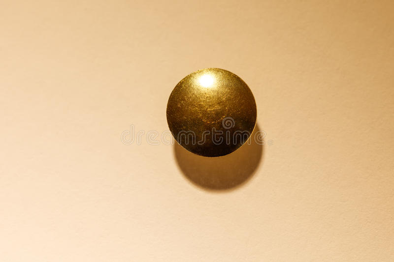 Golden Thumb Tack head royalty free stock photo