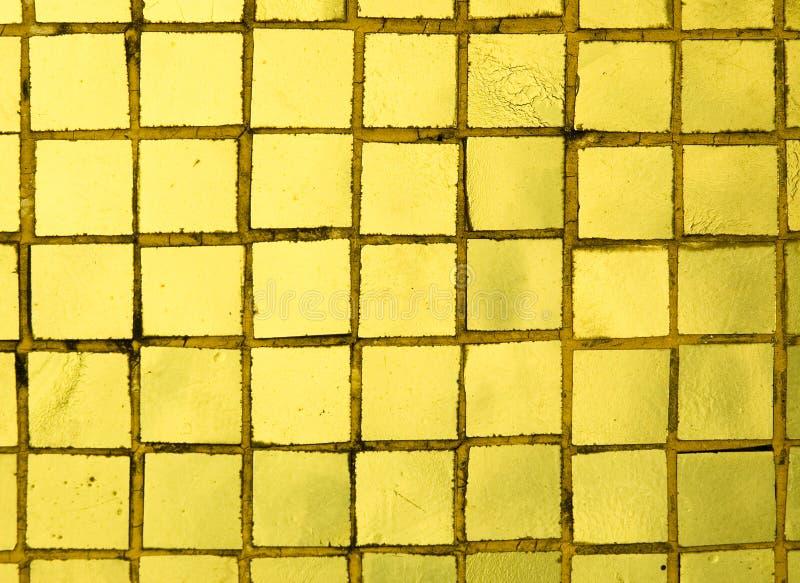 Golden tiles royalty free stock photos