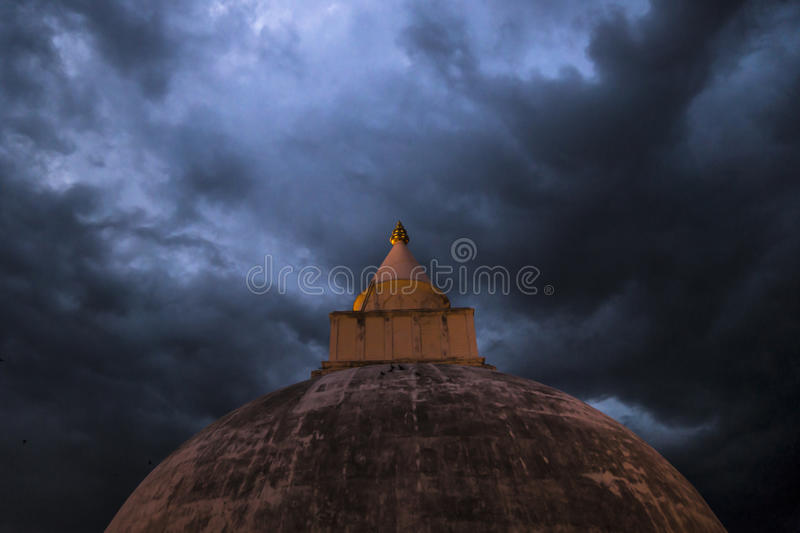 The golden Top in the storm, Yatala Wehera, Tissamaharama, Sri L. Stupa temple with stormy weather royalty free stock photo