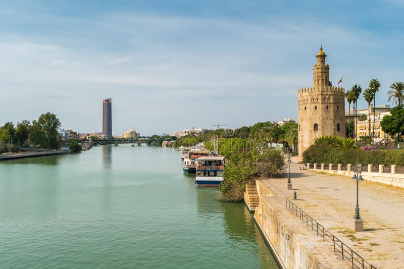 Golden tower or Torre del Oro along the Guadalquivir river, Seville, Andalusia, Spain. stock photos