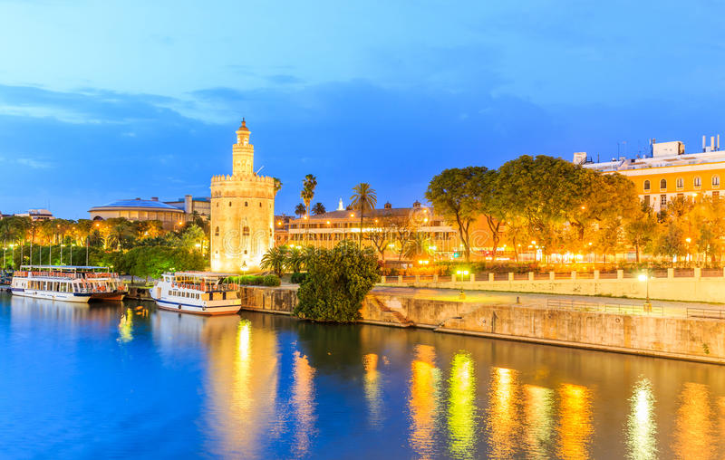 Golden Tower (Torre del Oro) of Seville, Andalusia, Spain. Over river Guadalquivir at sunset royalty free stock photo