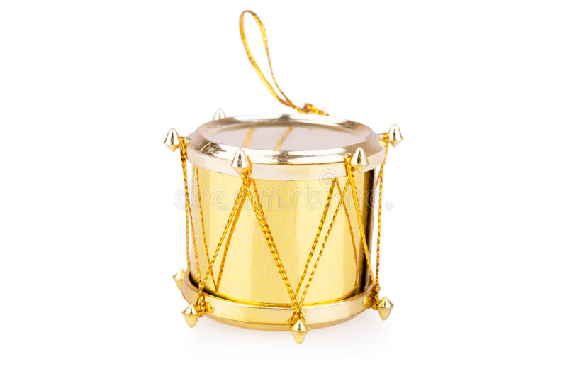 Golden toy drum. On a white background stock image