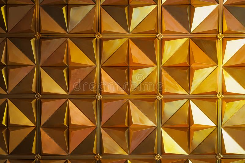 Golden triangle background or texture. Abstract architectural pattern royalty free stock photo