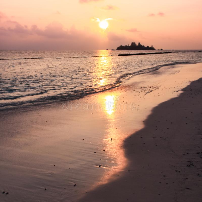 Sunset over Maldives Island Beach, Island and Pacific Ocean royalty free stock photo