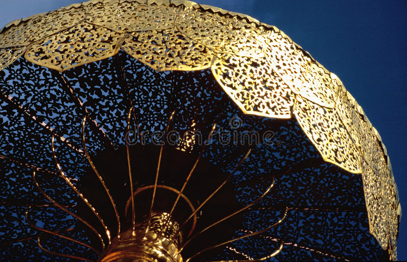 Golden umbrella royalty free stock photography