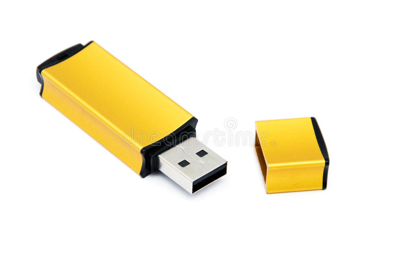 Golden USB Memory Stick. Isolated on a white background stock images