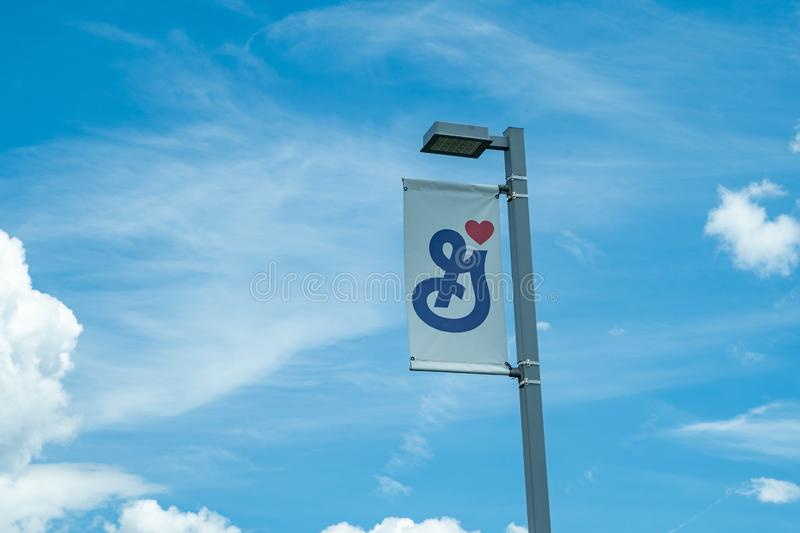 Golden Valley, Minnesota -  A Big G General Mills flag on a light pole at the General Mills headquarters in. A Big G General Mills flag on a light pole at the royalty free stock photos