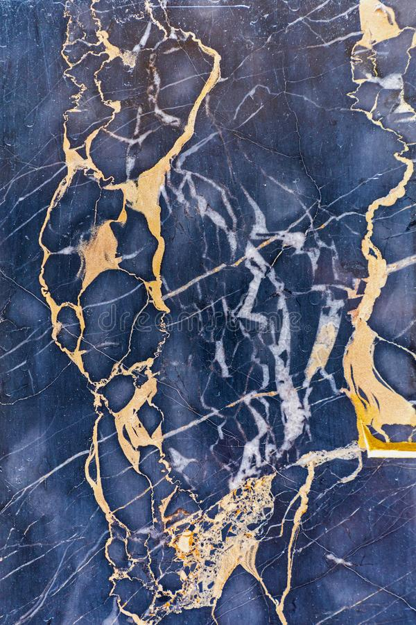 Gold Marble Veins. Golden Veins in Dark Marble Stone Luxury royalty free stock photography