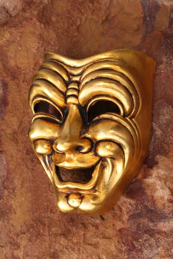 Golden Venetian mask. Representing comedy stock photo