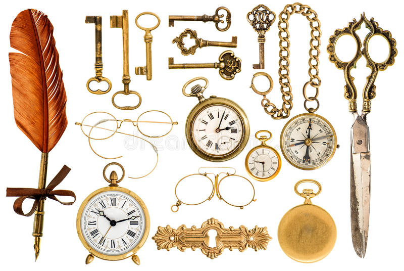 Golden vintage accessories. Antique keys, clock, glasses, scissors, compass stock photo