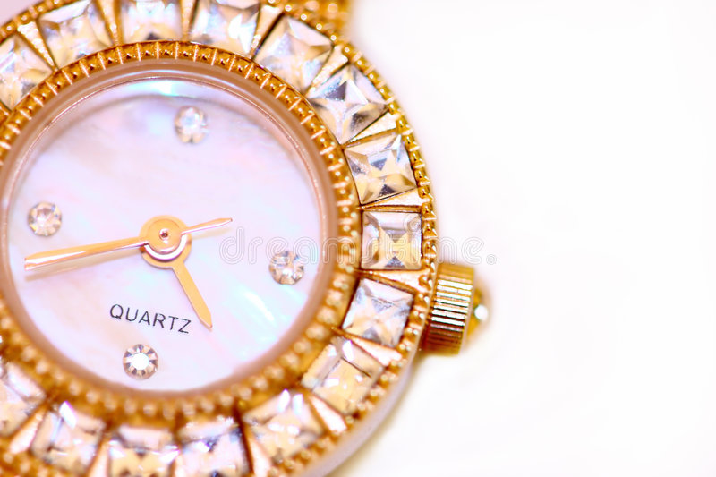 Golden watch with diamonds stock images