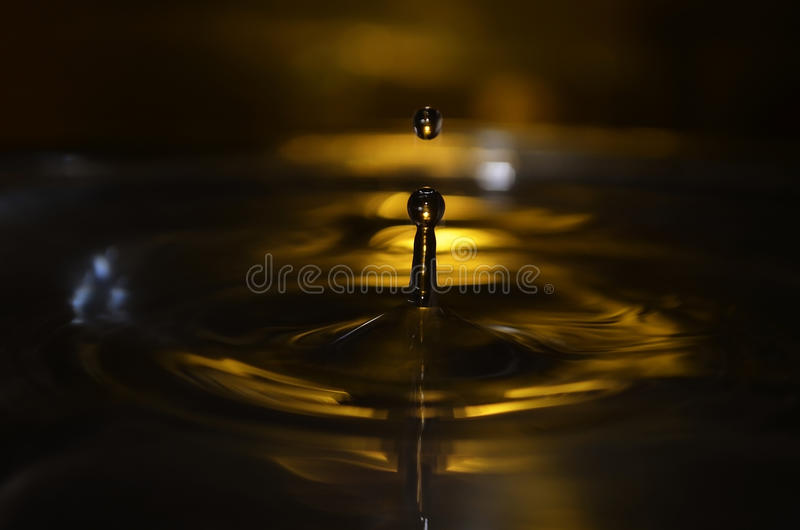 Golden Water Drop stock image