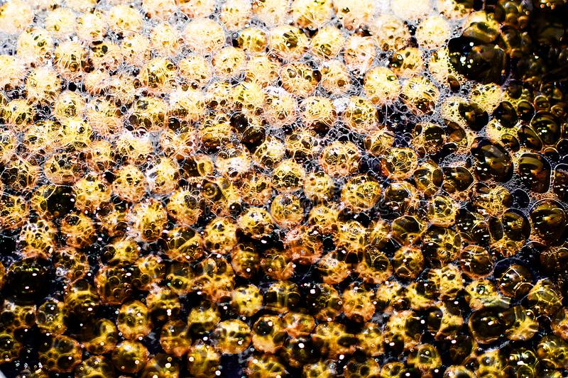 Golden water. magic bubbles, background stock image