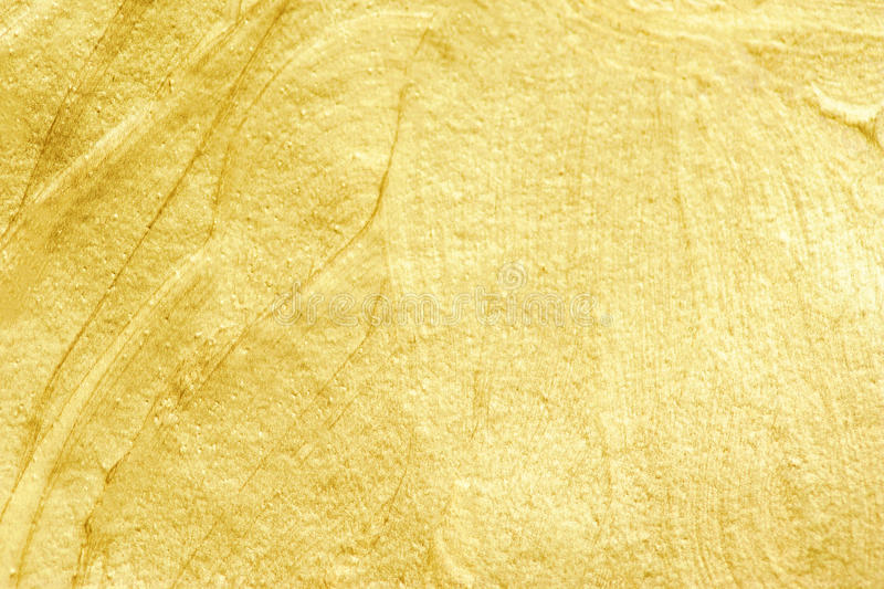 Golden watercolor textured background. Abstract gold glittering. stock images