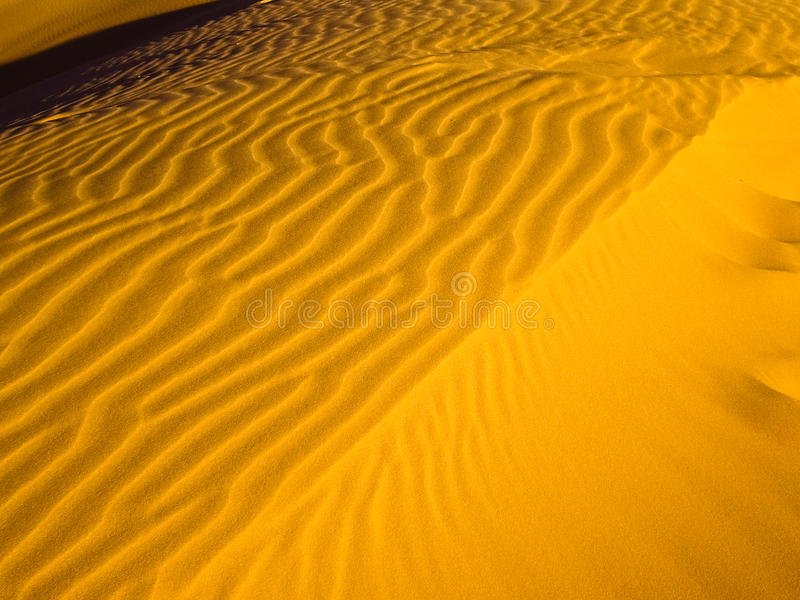 Golden Waves Of Sand Stock Image