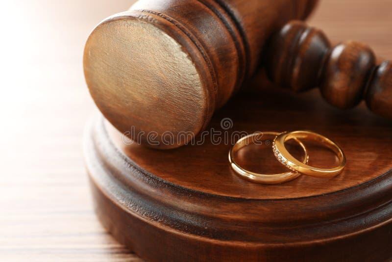 Golden wedding rings with judge gavel,. Closeup stock image