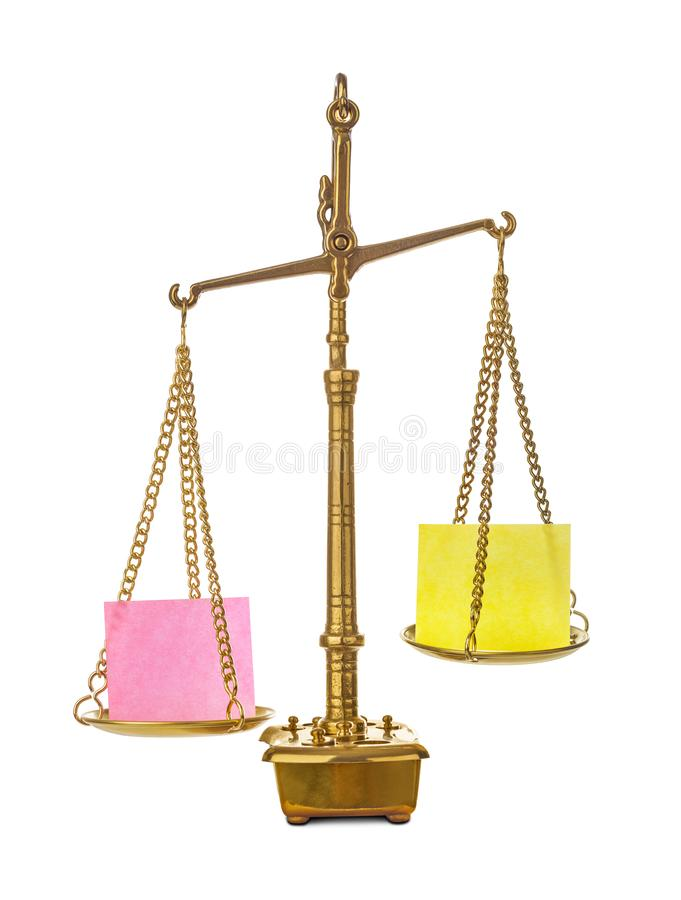 Golden weight balance scale with blank paper stock photos