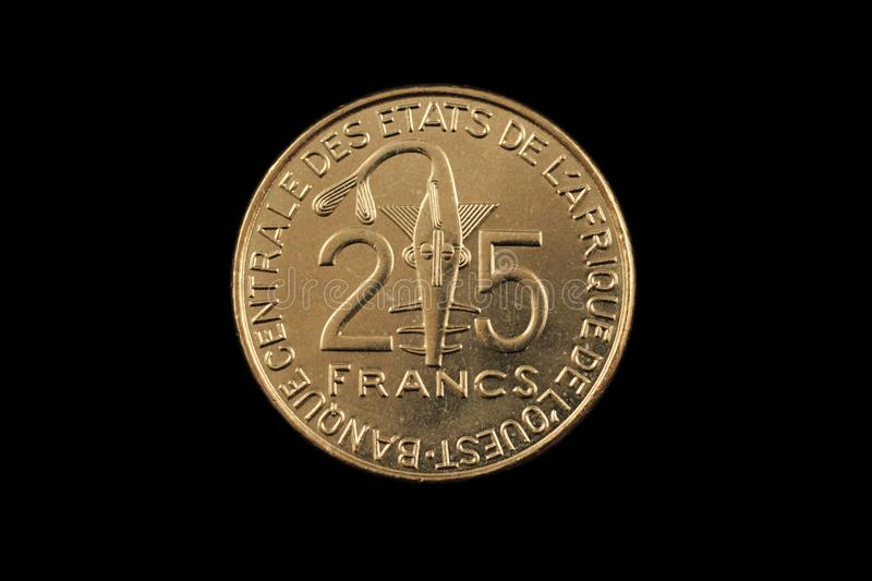Golden 25 West African Franc coin stock images