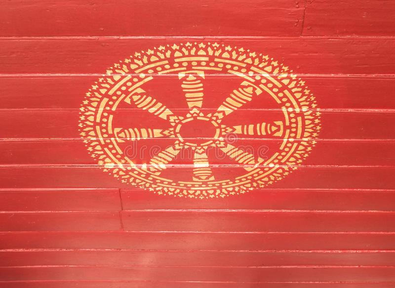 Golden wheel of life painting on the red wooden ceiling royalty free stock photography