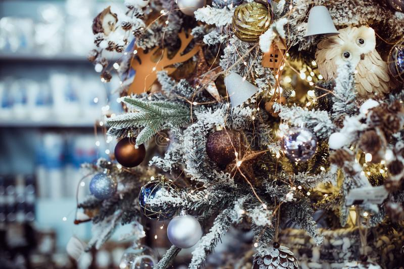 Golden and white Christmas ball decorations of different traditional styles and vintage designs on fur tree branches. Elegant Back. Ground for Greetings Card royalty free stock photography