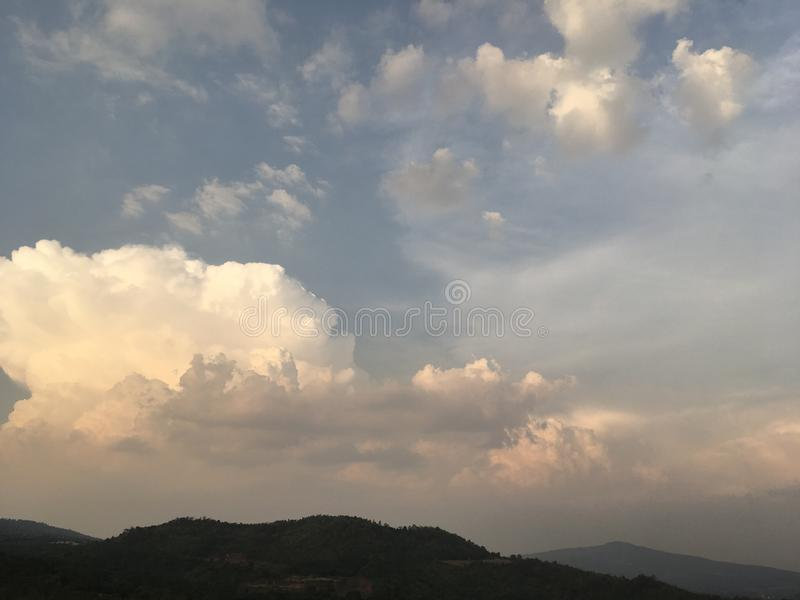 Golden white cloud at sunset. With blue sky and mountain view stock photo
