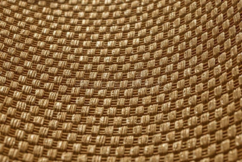 Golden wicker texture background, closeup stock photography