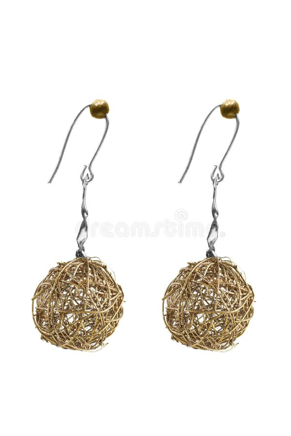 Wire drop earrings isolated. Golden wire ball drop earrings isolated over white stock photo