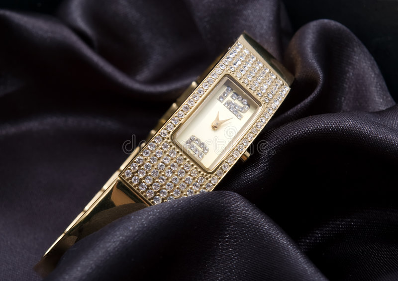 Golden woman watch stock image