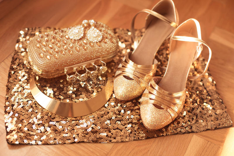 Golden. Womens clothes and accessories. Shoes. Luxury fashion. Jewelry. Expensive pendant close-up background. Shiny Crystal Precious Gem Jewels stock photography